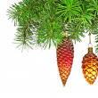 Christmas red and golden cones on new year tree — Stock Photo