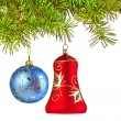 Christmas decoration-glass red bell and blue ball on fir branch — Stock Photo #18108761