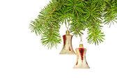 Christmas yellow bells on new year tree — Stock Photo