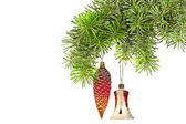 Christmas red cones and bell on new year tree — Stock Photo