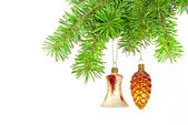 Christmas yellow bell and golden cone on new year tree — Stock Photo