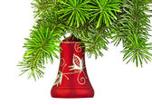Christmas red bell on new year tree — Stock Photo