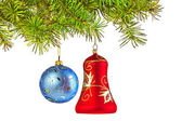 Christmas decoration-glass red bell and blue ball on fir branch — Stock Photo
