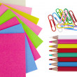 Colorful pencils, clips and note papers on white background — Stock Photo
