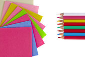 Colorful pencils and note papers on white — Stock Photo