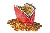 Old red purse and golden coins. — Stock Photo