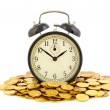 Beautiful old clock staying on one golden coins. Time is money c — Stock Photo