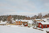 Wooden houses on the river coast in Porvoo town, Finland — Stock Photo