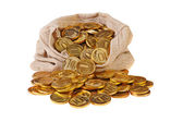 Gold coins fall out of a canvas bag — Stock Photo