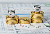 Financial chart, coins and dice cubes with the words Sell Buy. S — Stock Photo