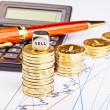 Downtrend coins stacks, calculator, pen and dices cube with the — Stock Photo