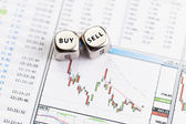 Dices cubes with the words SELL BUY on downtrend financial diagr — Stock Photo