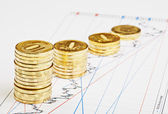 Downtrend coins stacks on financial chart. Selective focus — Stock Photo