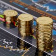 Uptrend stacks coins,on the financial stock charts as backgrou - Stock Photo