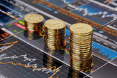 Uptrend stacks coins,on the financial stock charts as backgrou — Stock Photo