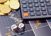 Dices cubes with the words SELL BUY, calculator and golden coins — Stock Photo