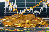 Golden coins and financial chart as background — Stock Photo