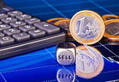 Dices cube with the word SELL, euro coins, calculator and downtr — Stock Photo
