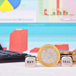 Dices cubes with the words  SELL, BUY one-euro coin, calculator  — Stockfoto