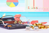 Dices cubes with the words BUY SELL, golden coins, calculator,gl — Stock Photo