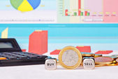 Dices cubes with the words SELL, BUY one-euro coin, calculator — Stock Photo