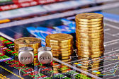 Uptrend stacks golden coins, dices cubes with the worsd SELL BUY — Stock Photo