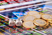 Dices cubes with the words SELL BUY, one-euro coins and a financ — Stock Photo