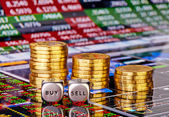Stacks of coins, dices cubes with the words SELL BUY and down tr — Stock Photo