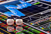Dices cubes to trader. Cubes with the words SELL BUY on financia — Stock Photo