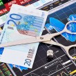 Scissors cutting  euro  banknote, dices cube with the word SELL. — Stock Photo
