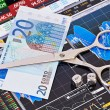 Scissors cutting  euro  banknote, dices cubes with the words SEL — Stock Photo