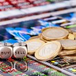 Dices cubes with the words SELL BUY, one-euro coins and a financ - Stock Photo