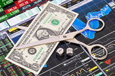 Scissors cutting one-dollar banknote, dices cubes with the word — Stock Photo