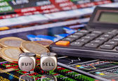 Dices cubes with words SELL BUY for trader, euro coins and calcu — Stock Photo