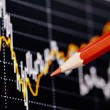 Financial chart with the red pencil. Selective focus — Stock Photo