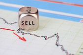 Downtrend financial market chart with red arrow and dices cube w — Stock Photo