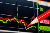 Downtrend financial chart with the red pencil. Selective focus — Stock Photo