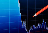 Downtrend financial chart and the red pencil.Dark background. Se — Stock Photo