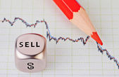 Downtrend chart,red pencil and dice cube with the word SELL. Sel — Stock Photo