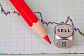 Financial downtrend chart, red pencil and dice cube with the wo — Stock Photo