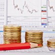 Downtrend coins stacks, red pencil, financial chart as backgroun — Stock Photo #29836051