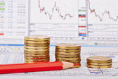 Downtrend coins stacks, red pencil, financial chart as backgroun — Stock Photo
