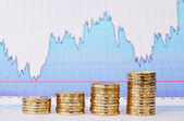 Uptrend stacks of golden coins and financial chart as backgrou — Stock Photo