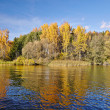 Sunny autumn day on the lake in Russia — Stock Photo #34308787