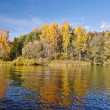 Sunny autumn day on the lake in Russia — Stock Photo