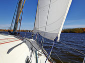 Yacht sailing on the lake in sunny autumn day — Stock Photo