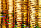 Stacks of golden coins and financial chart. Selective focus — Stock Photo