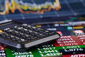 Calculator and financial chart as background. Selective focus — Stock Photo