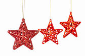 Christmas decoration. Red stars on white background. Selective f — Stock Photo