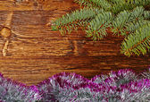 Christmas decoration. Fir-tree, tinsel and wooden background. Se — Stock Photo